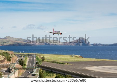FUNCHAL, PORTUGAL - Nov 13: Passenger plane from airline easyJet approaches to Funchal Airport on November 13, 2014 at Madeira, Portugal - stock photo