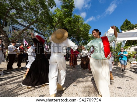 FUNCHAL, PORTUGAL - SEPTEMBER 1, 2016: Dancers with local costumes demonstrating a folk dance during the Wine Festival in Funchal on the Madeira, Portugal.