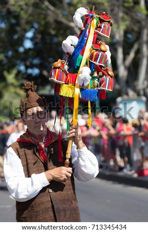 FUNCHAL, PORTUGAL - SEPTEMBER 3, 2017: Man in historical fashion dress during historical and ethnographic parade of Madeira Wine Festival in Funchal. Madeira, Portugal.