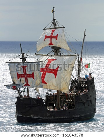 "FUNCHAL, PORTUGAL - SEPTEMBER 23: Replica ot vessel ""Santa Maria"" is passing the port of Funchal on September 23, 2013 during a cruise along the southern coastline near Funchal (Madeira, Portugal). - stock photo"