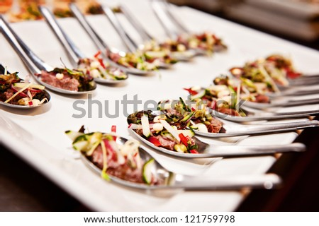 function food; a platter of function food on spoons - stock photo