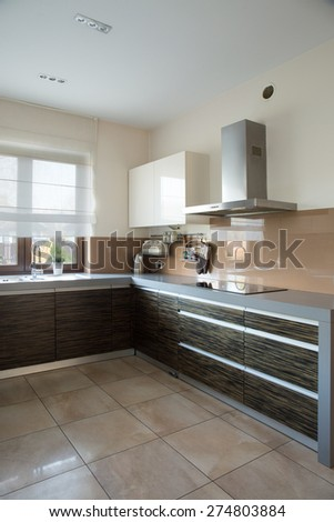 Functional contemporary kitchen with wide worktop - stock photo