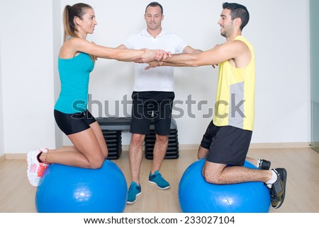 Functional training with coach on ball - stock photo