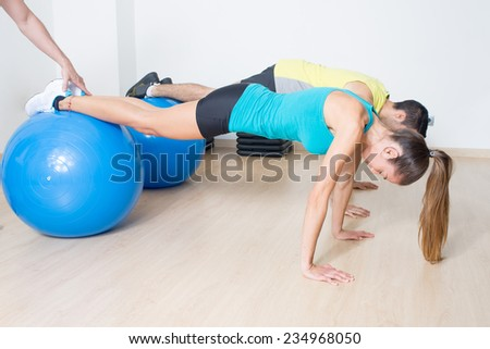 functional training with med ball with help of coach - stock photo