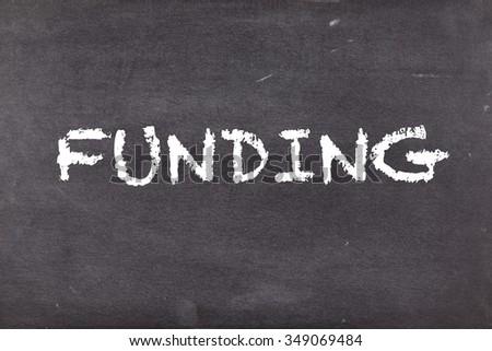 Funding, concept on school blackboard or chalkboard - stock photo
