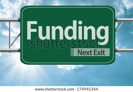 Funding road sign on a beautiful day - stock photo