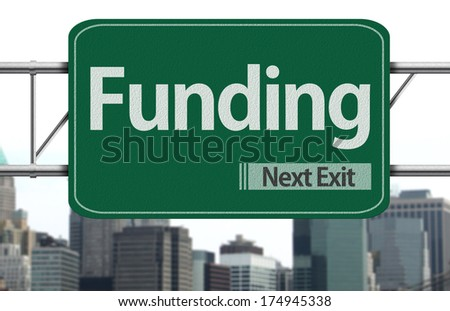 Funding road sign on the city - stock photo