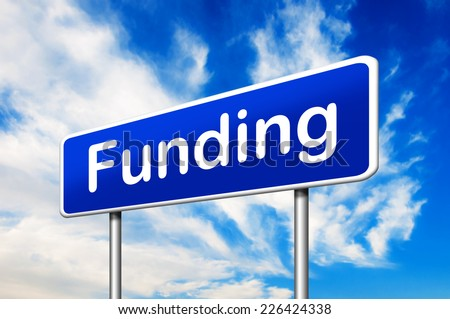 Funding road sign with a blue sky in a background - stock photo