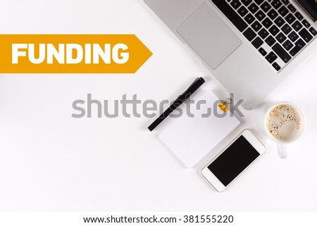 Funding text on the desk with copy space - stock photo