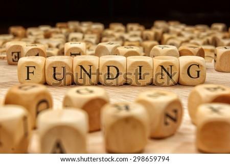 FUNDING word written on wood block - stock photo