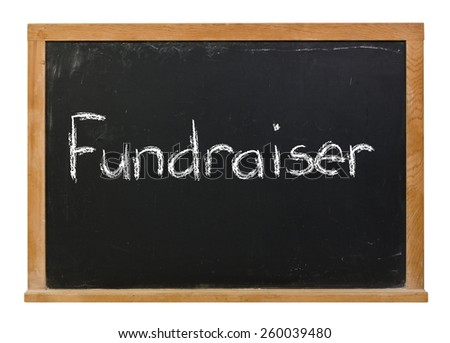Fundraiser written in white chalk on a black chalkboard isolated on white