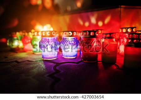 Funeral candle lamps at night - stock photo