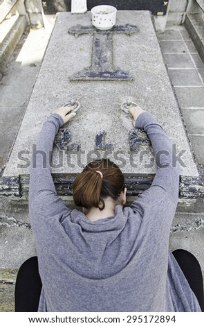 Funeral crying woman on marble tomb, religion - stock photo