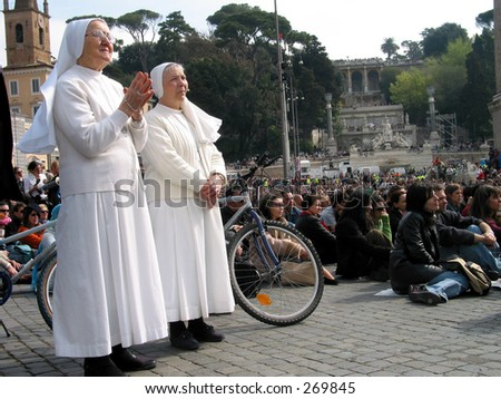 funeral day of the pop in Rome italy, piazza del popolo, people are watching silently the funeral ceremony of the pop in Rome italy.  8 april 2005