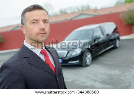 funeral director with car - stock photo