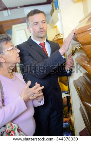 funeral director with customer - stock photo