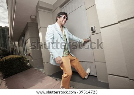 Funky male trying to pull the door open