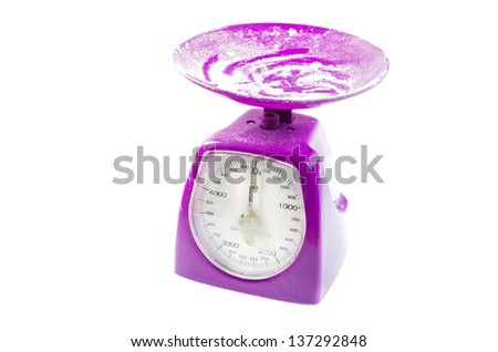 Funky purple kitchen scale with a large overhead metal pan and dial for weighing cooking ingredients isolated on a white background - stock photo