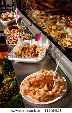 Funnel Cakes For Sale At A County Fair - stock photo