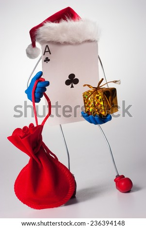 Funny ace card character with gifts wearing christmas hat - stock photo