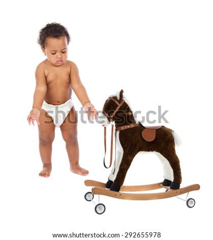Funny african baby in diaper with a wooden horse isolated on a white background - stock photo