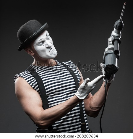funny aggressive mime holding puncher