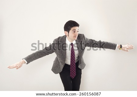 Funny and drunk businessman flying gesture
