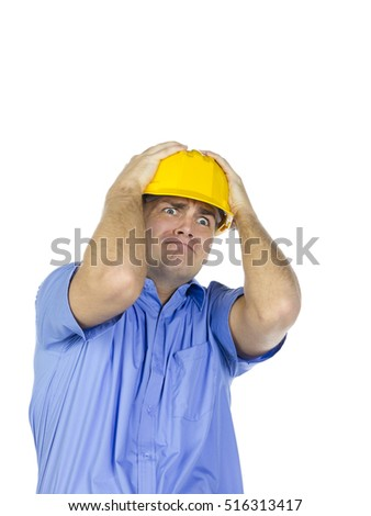 Funny and humorous portrait of young handsome male construction worker working on a laptop but having some trouble isolated on white background
