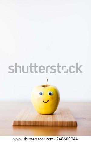 funny apple face - stock photo