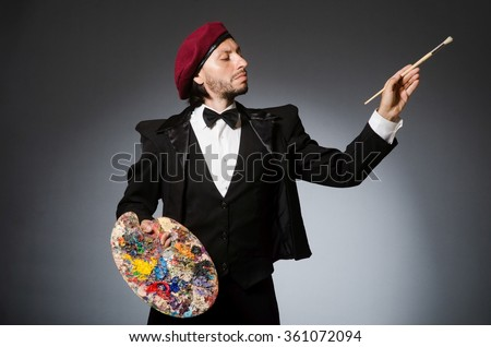 Funny artist working in the studio - stock photo