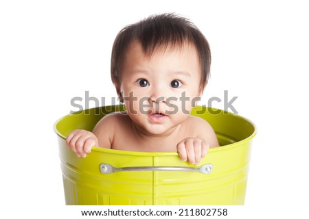 Funny Asian baby portrait isolated on white - stock photo