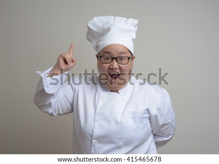funny asian chef woman dress in white - stock photo