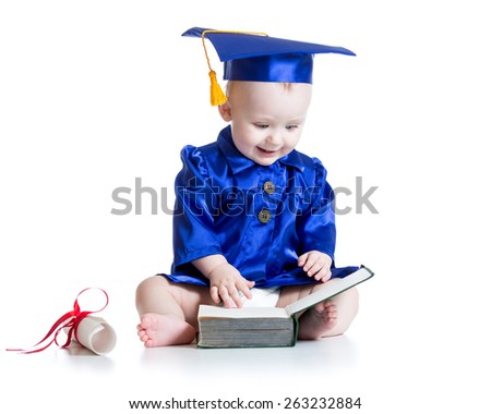 funny baby boy in student hat looking at book - stock photo