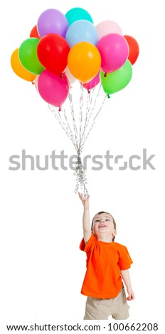 Funny baby boy  with bunch of colourful balloons flying up. Isolated on white.
