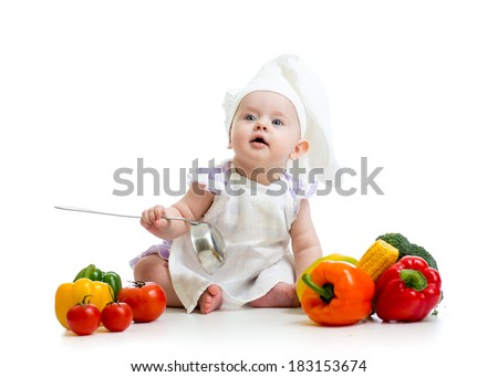 funny baby cook with vegetables - stock photo