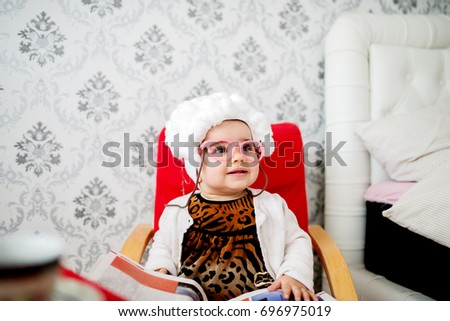Funny baby costumed like a granny sitting in the chair. & Funny Baby Costumed Like Granny Sitting Stock Photo (Royalty Free ...