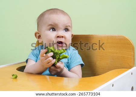 Funny baby doesn't like broccoli - stock photo