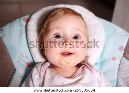 funny baby eating dirty grimy - stock photo