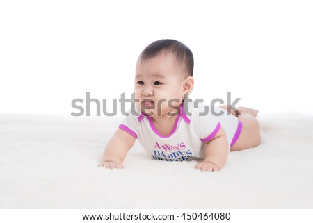 Funny baby girl crawling on floor