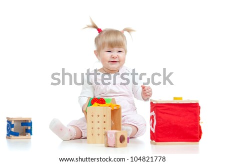 funny baby girl playing with color educational toy - stock photo