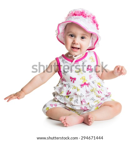 Funny baby girl sitting over white background
