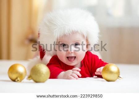 funny baby girl weared in Santa hat - stock photo