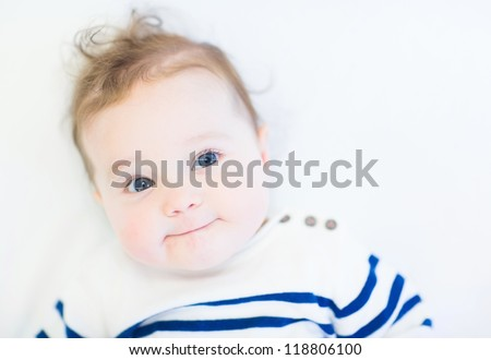 Funny baby in a striped navy shirt - stock photo