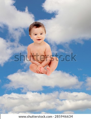 Funny baby in diaper sitting on a cloud on the sky - stock photo