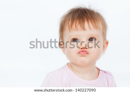 Funny baby, on a gray background - stock photo