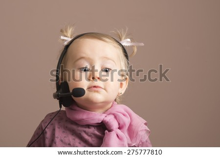 Funny baby on the phone as an operator - stock photo