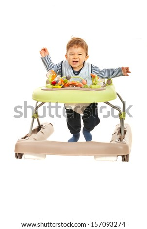 Funny baby running to you in walker isolated on white background - stock photo