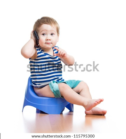 funny baby sitting on chamber pot and listening music - stock photo