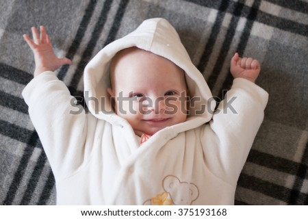 funny baby wakes up and stretches - stock photo