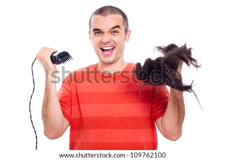 Funny bald man holding his long shaved hair and hair trimmer, isolated on white background.
